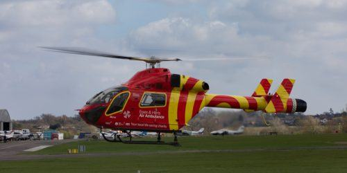Essex & Herts Air ambulance helicopter taking off