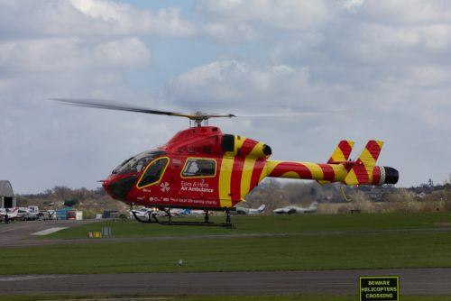 Essex & Herts Air ambulance charity helicopter taking off