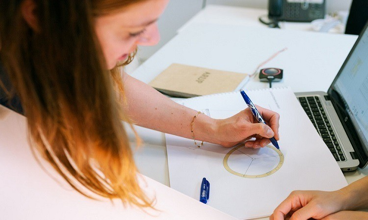 Lady designing with pen and paper